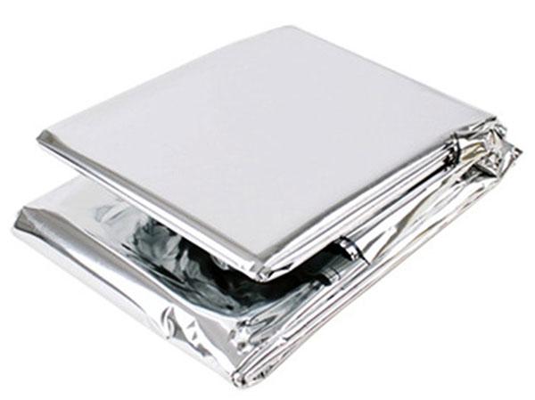 Folded silver colored mylar blanket