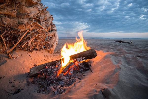 Building a fire on the beach